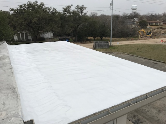 - Two coats of GacoRoof applied to roof surface