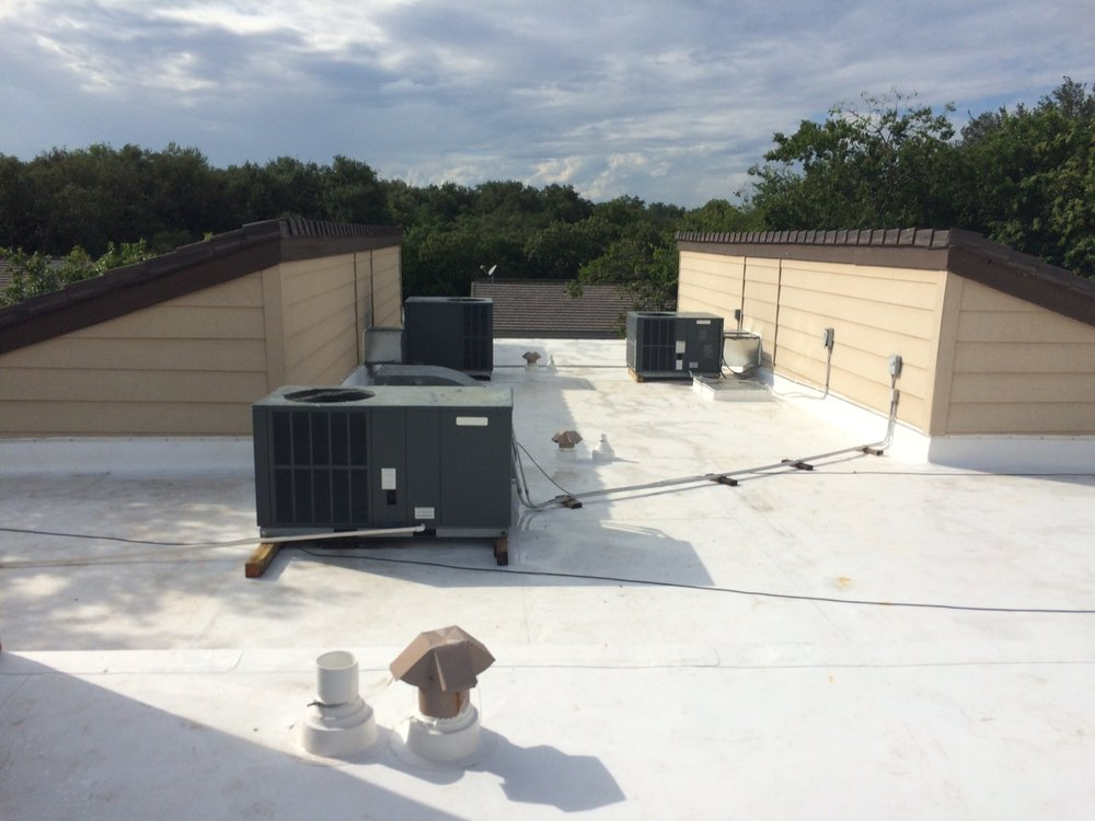 "Wurzbach Suites, San Antonio TX - New Boral tile, Versico 60 Mil TPO, 6"" guttering"