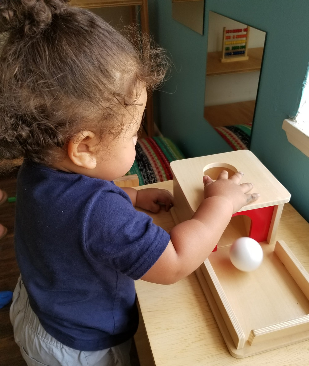 A child using the Object Permanence box in our  Pre-Primary  classroom.
