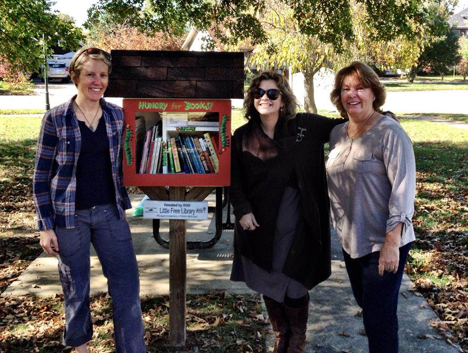 Jodi (on left) at one of the seven Little Free Library locations.