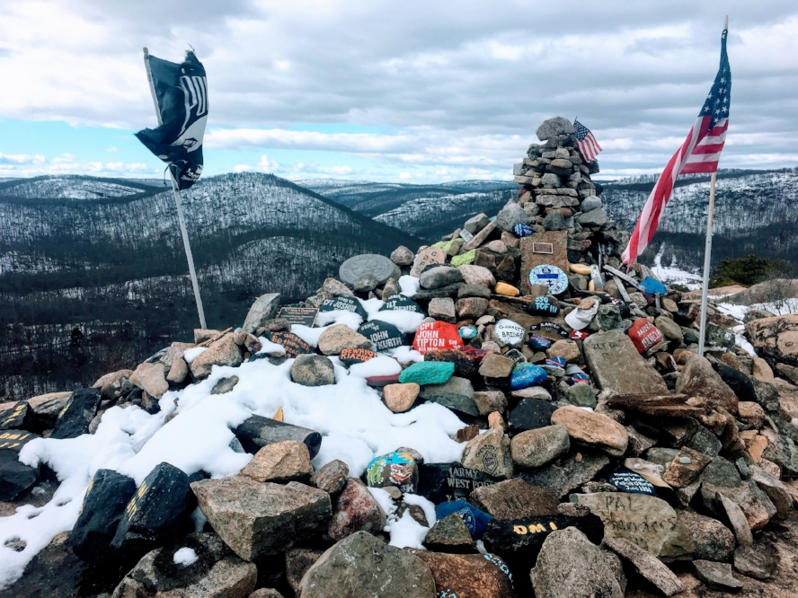 """These rocks were carried from the bottom and stacked here as a tribute to American soldiers now serving on the Frontier of Freedom. To their safe return."""