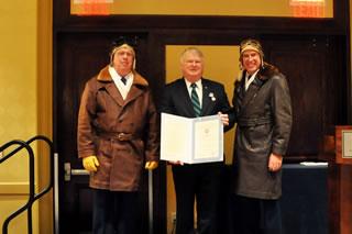 Captain Mont Smith receives a Public Service Award November 12, 2011