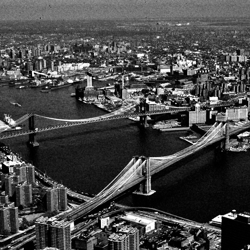 Manhattan_and_Brooklyn_bridges_on_the_East_River_New_York_City_NYC-Untapped-Cities1 2.jpg