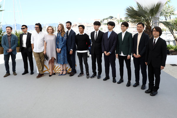 (L-R) Charles Williams, Wei Shujun, Saeed Jafarian Tariki, Marta Pajek III, Celine Held, Logan George, Raymund Ribay, Kawamura Genki, Toyota Masayuki, Hirase Kentaro, Seki Yutaro and Sato Masahiko attends Realisateurs Des Courts Metrages 2018 Photocall during the 71st annual Festival de Cannes at Palais des Festivals on May 18, 2018 in Cannes, France.
