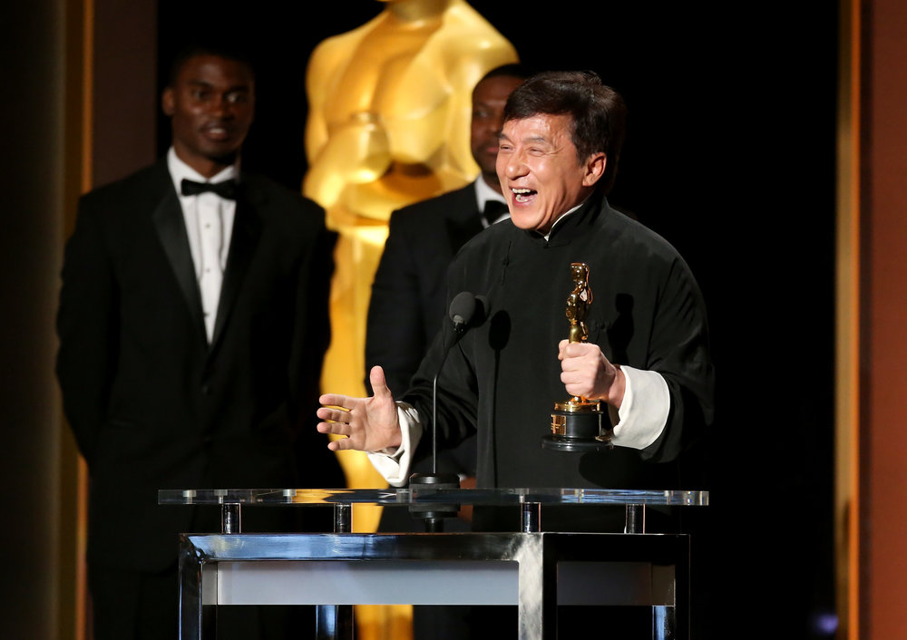 Jackie Chan receiving an honourary Academy Award (2016) - Photo by Frederick M. Brown/Getty Images Entertainment / Getty Images