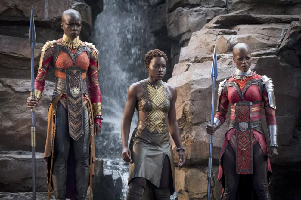 Nakia (Lupita Nyong'o) is flanked by Okoye (Danai Gurira) and Ayo (Florence Kasumba), two members of Wakanda's Dora Milaje in Black Panther (2018) - Marvel/Disney
