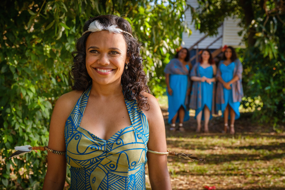 Top End Wedding  (2019) The bride Lauren (Miranda Tapsell) with her three bridesmaids in the background - Dana (Elaine Crombie), Ronelle (Shari Sebbens), Kailah (Dalara Williams) - Courtesy of Goalpost Pictures