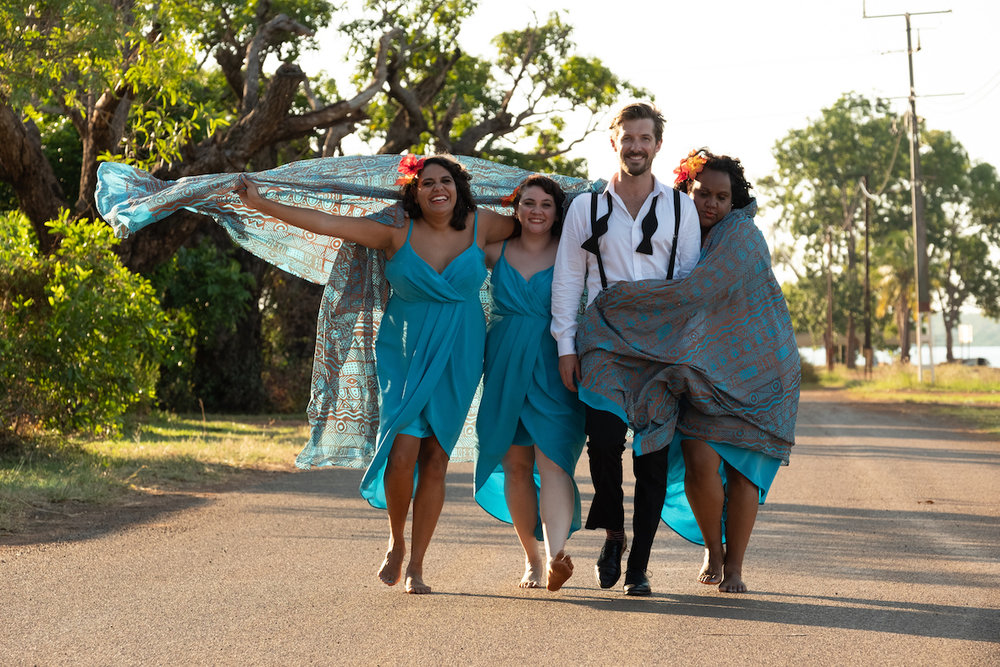 The groom, Ned (Gwilym Lee) with the three bridesmaids (from left) Kailah (Dalara Williams), Ronelle (Shari Sebbens) and Dana (Elaine Crombie) - Courtesy of Goalpost Pictures