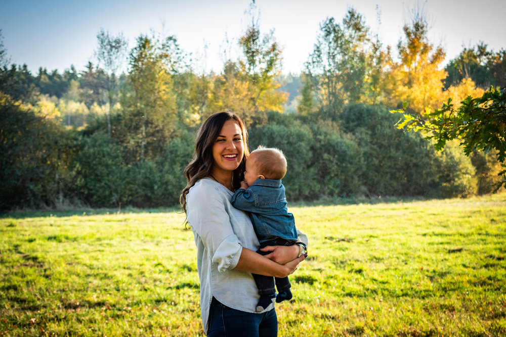 """Baby Giggles Galore - """"Terri and I were talking to Rowan, when he just smiled, put his hands in his mouth, and quickly hid into his mom's chest."""""""