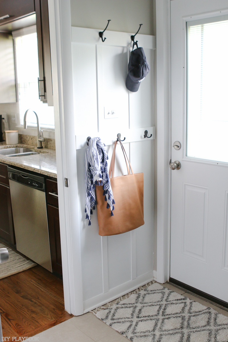 DIY Playbook makes great use of this itty bitty space. This little wall truly feels like a distinctly defined entryway.