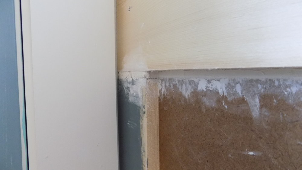 This was one of the larger gaps that needed to be filled. At the end it looked like we were working with perfect materials because you really can't see the difference between the putty and the boards.