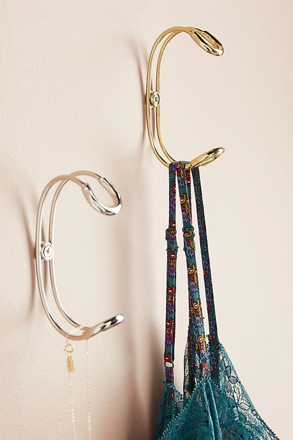I started my search at Anthropologie, my favorite spot for funky hardware. I fell in love with this wire look but couldn't get over the $18/each price tag.