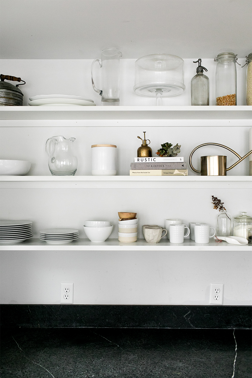The all white shelves look so clean and tidy. I have a lot of colorful dishes that I want to display, so the white would be a good base for letting my dishes steal the show.