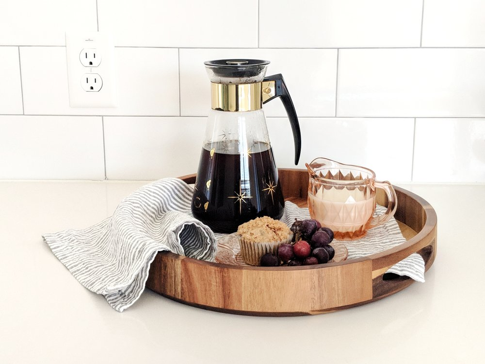 Our carafe with a depression glass creamer.