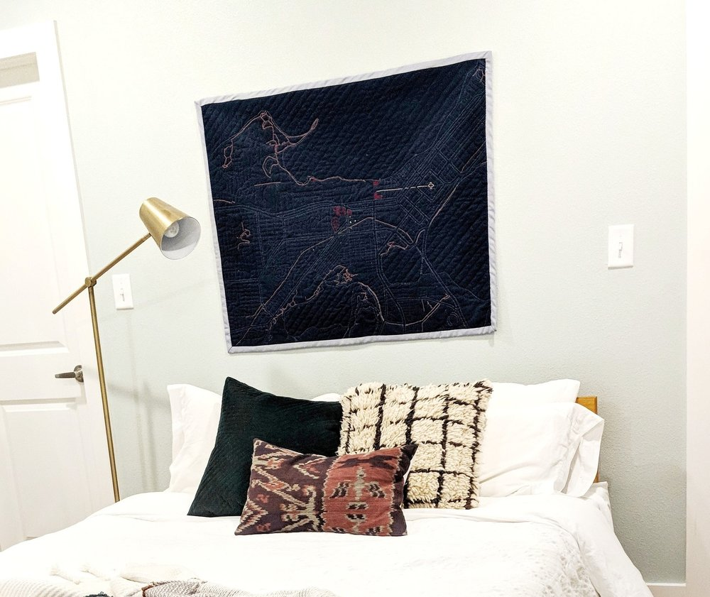 Before — You can see the mismatched pillows and quilt hanging wasn't feeling as luxurious as we wanted it to.