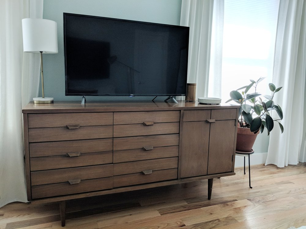 The credenza was being crowded by the TV, and we were missing out on valuable countertop real estate with the TV taking up so much space.