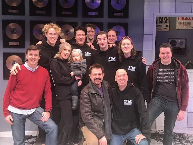 One last family photo on the stage of the CAA Theatre upon closing.