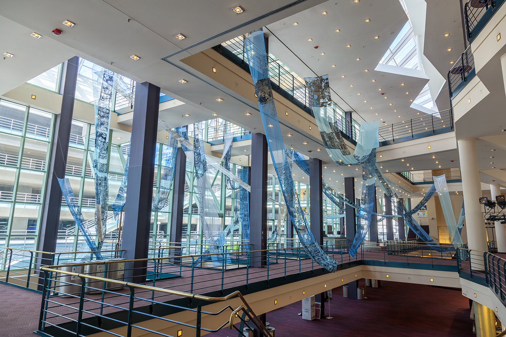 Meandering/Buell Theater/Denver, CO - In collaboration with the 2016 Biennial of the Americas and Denver Arts and Venue, Theresa Clowes' installation work meandered through the Denver's Buell Theater atrium.Meandering is a visual articulation about collecting data derived from five-mile segments of Colorado's Big Thompson River.