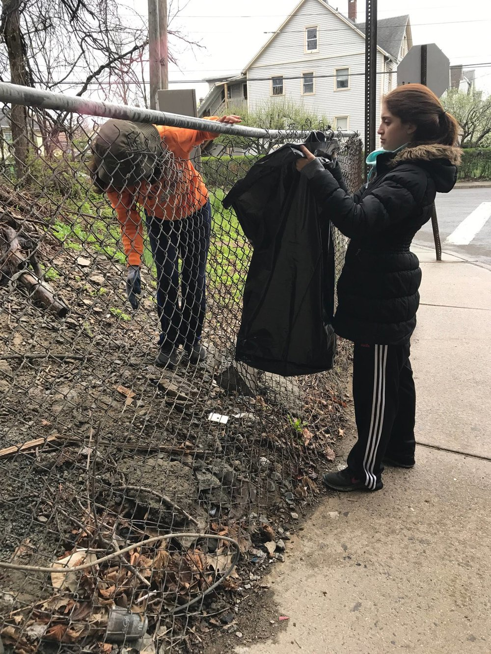 Debbie and Steph picking up garbage on Lockwood under the 95 bridge. One block from DOMUS. A clean neighborhood is the most basic foundation of education.
