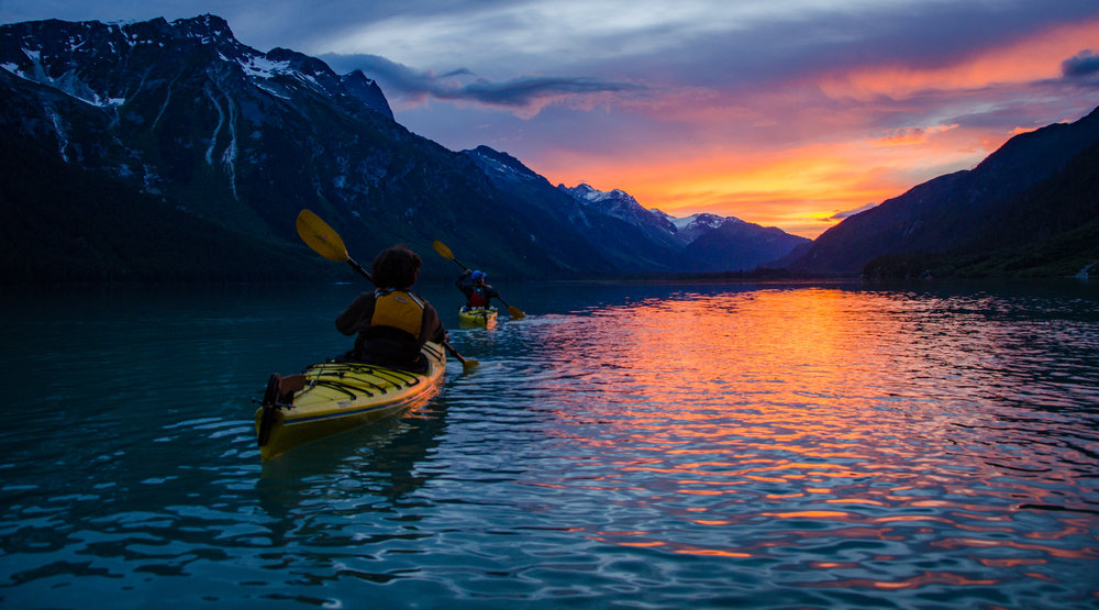 Kayaking into the sunset.   Haines, Alaska