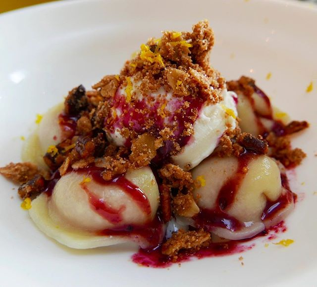 "Come try the newest addition to our menu - ""99 problems but a berry ain't 1"" is a mixed berry cheesecake dumpling with gluten free crumble, vanilla ice cream and a sweet berry drizzle topped with some lemon zest. 🍓🍒"