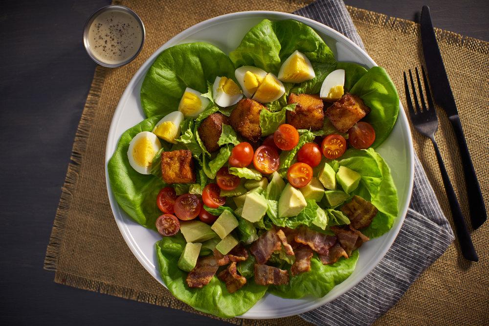 COBB SALAD:  lettuce, bacon, avocado, egg, croutons, tomatoes, garlic & lemon vinaigrette