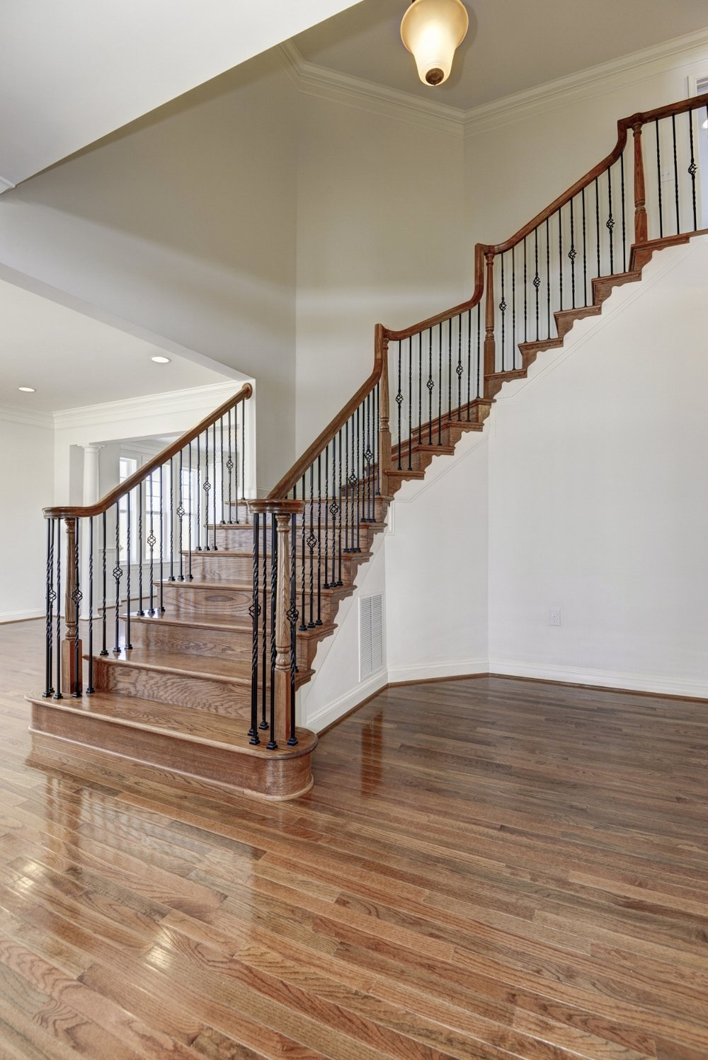 Open Oak Staircase With Iron Balusters