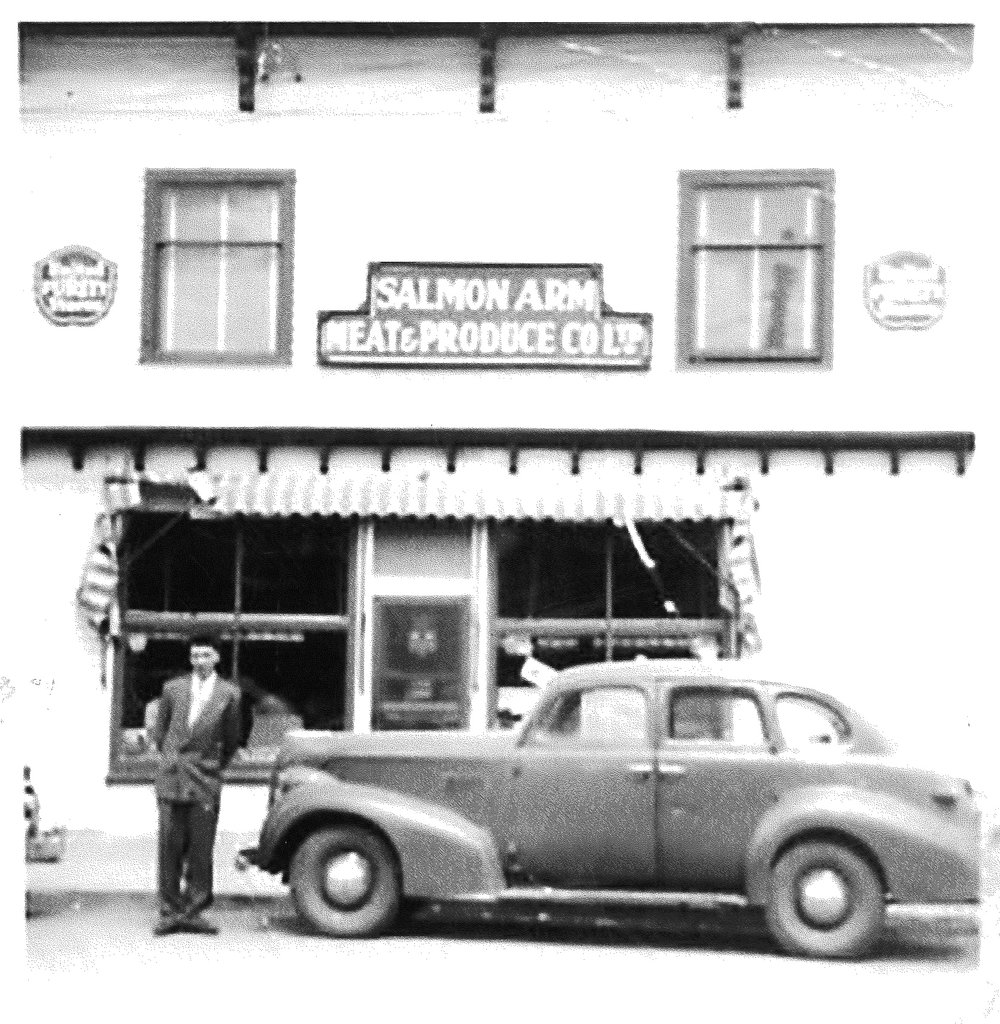 Donnie Askew in front of Salmon Arm Meat & Produce, the late 1940's