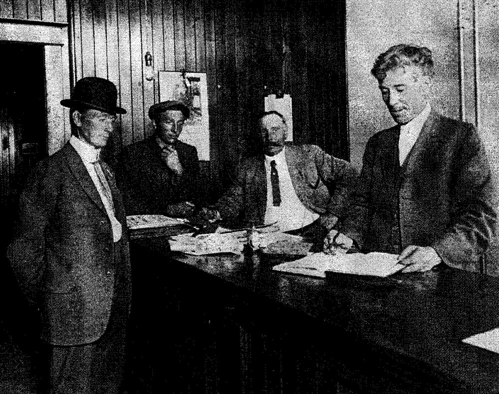 Dick Askew (hand at neck) at the Kamloops Land Registry Office in 1913