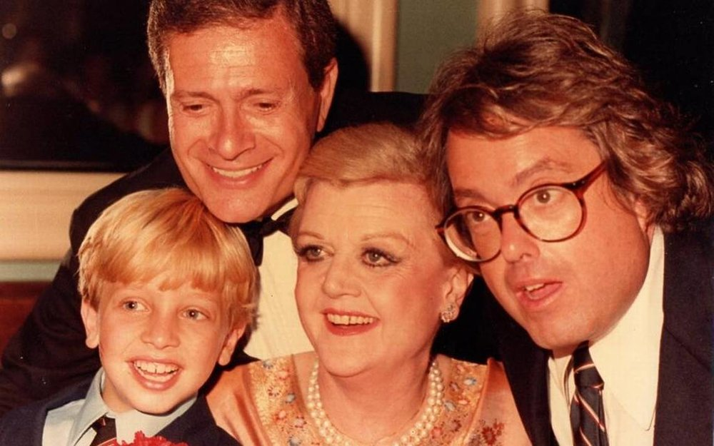 Little Roshi Handwerger (now WSVN reporter Rosh Lowe) with composer Jerry Herman, Angela Lansbury and 'La Cage aux Folles' producer Allan Carr at the opening night party for the 1983 Broadway revival of 'Mame.'Photo provided by Rosh Lowe