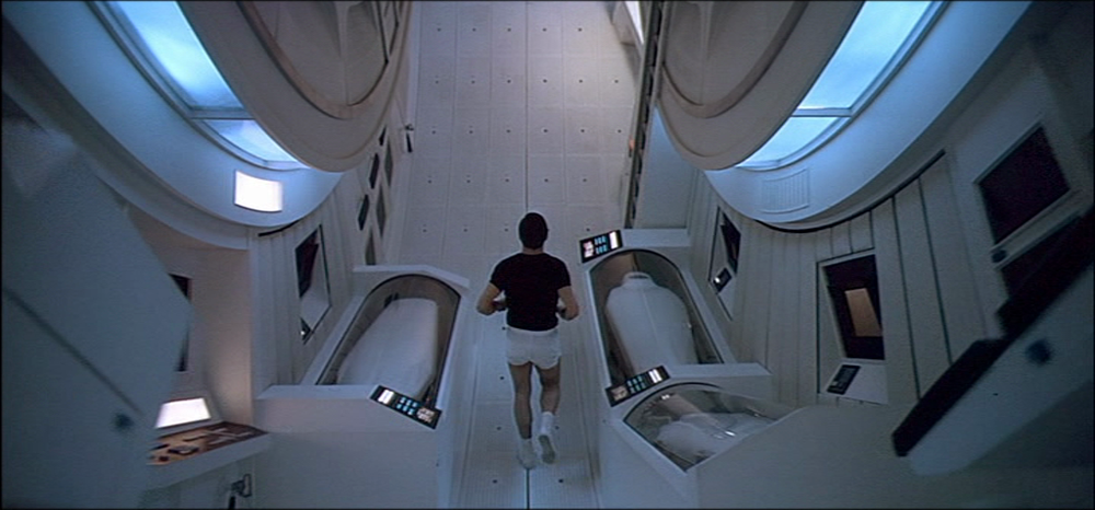 Scene from 2001: A Space Odyssey where the main character jogs around a centrifuge.
