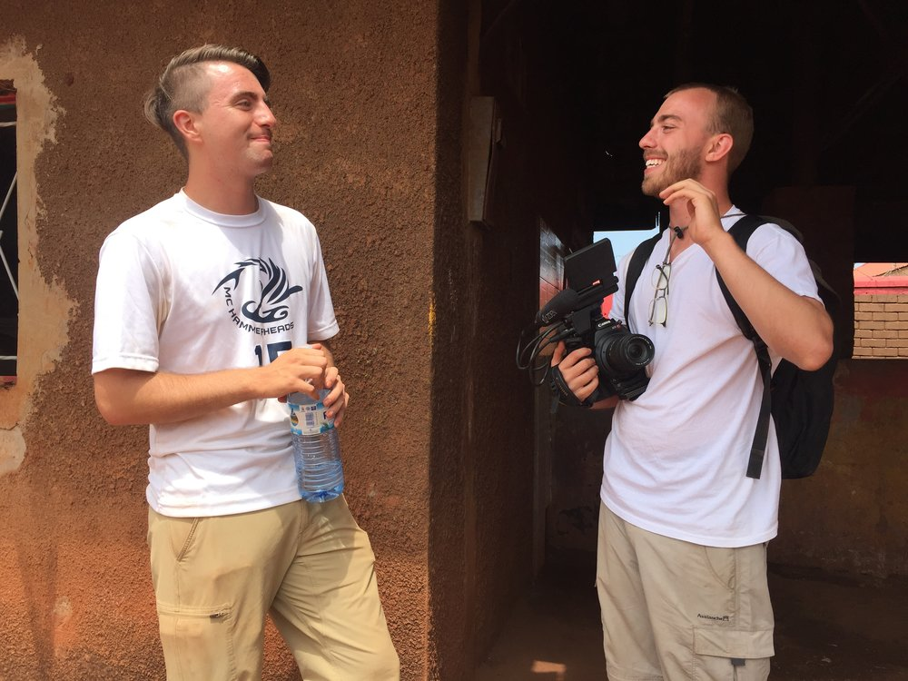 Chris Martin (left) & Jesse Manning (right) collaborating in Masese, Uganda