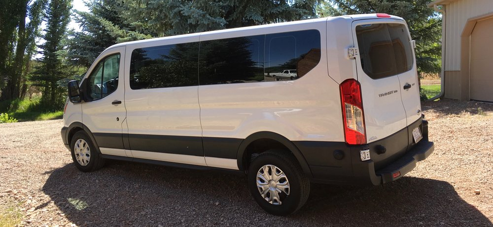 Our 2016 Ford Transit comfortably seats 14 guests.