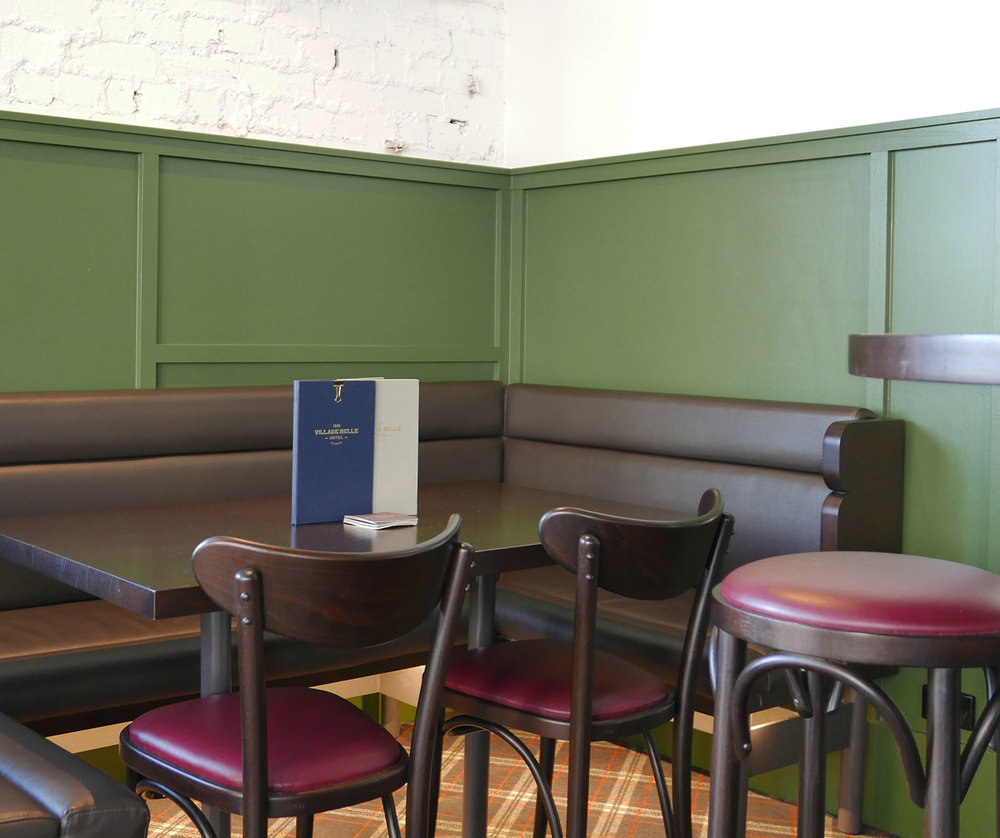 Padded booth seating in the front bar.