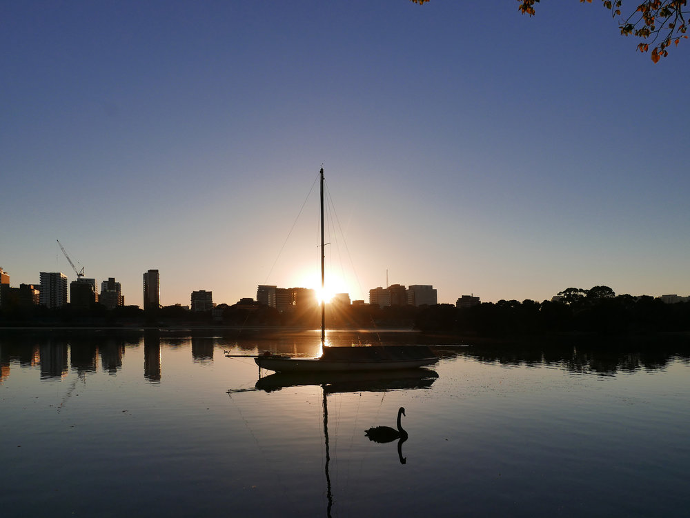 Sailing-sunrise-over-lake.jpg