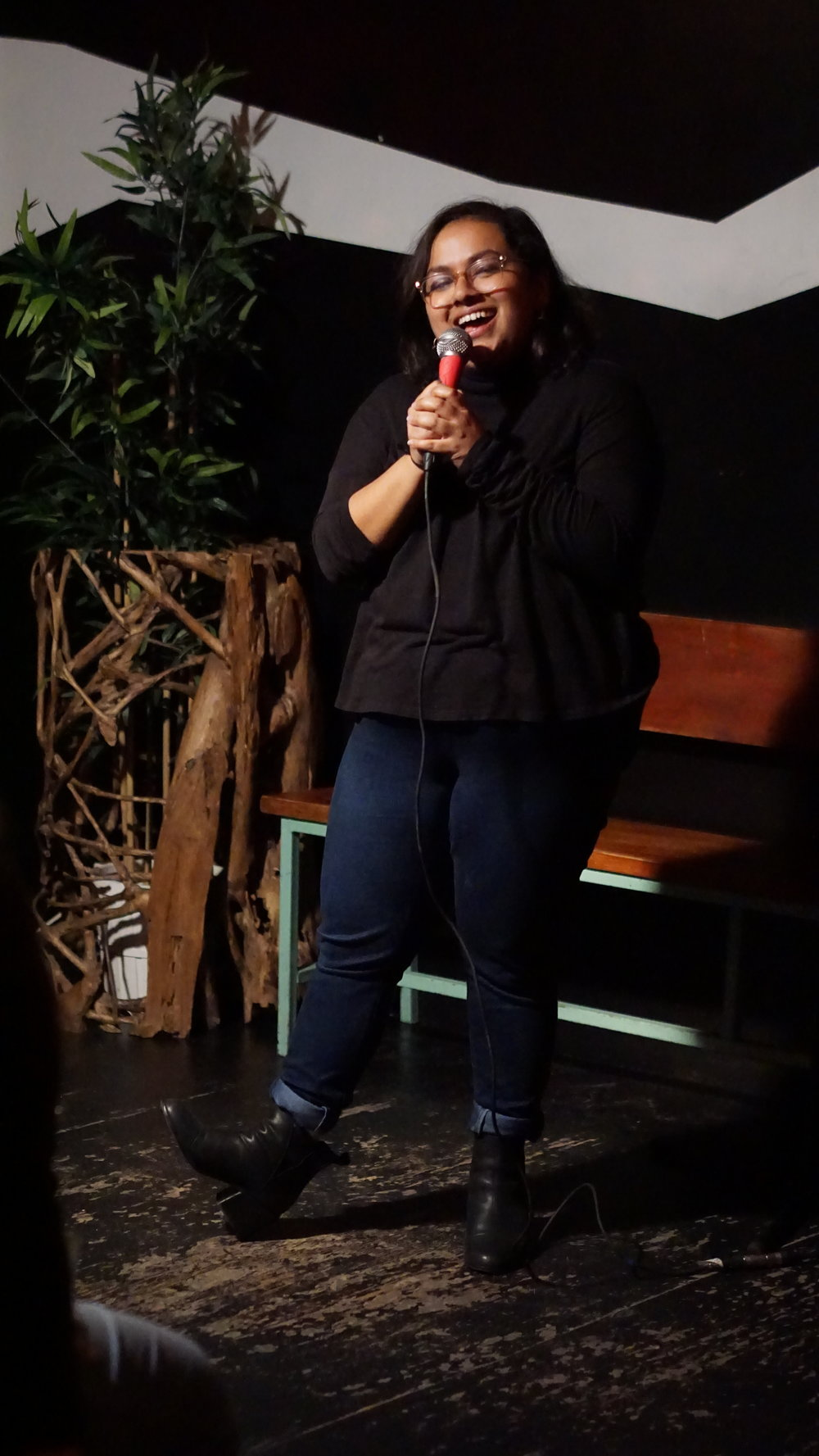 """Isha Patnaik performs in front of an audience of 200 at Tufts Comedy Blastoff. She admits that this outfit was a """"fashion risk"""" but still plans on repeating it."""