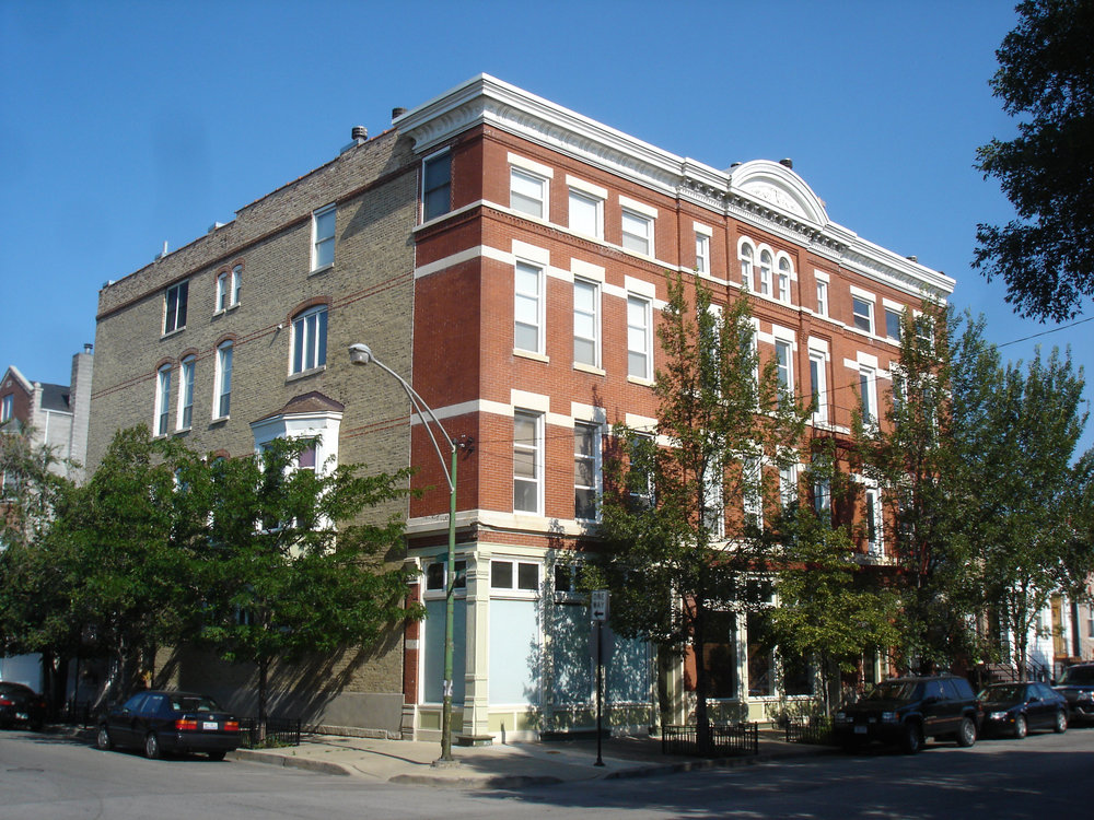 multi-family residential gut renovation, 1890s brick masonry apartment building, converted storefronts into residences, new two-story units, roof deck