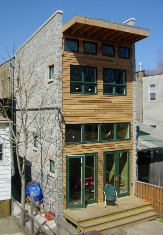 modern addition on 1890s single-family brick rowhouse, french doors