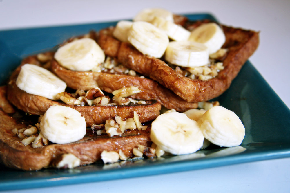 Jonas topped his french toast with bananas, chopped walnuts, and maple syrup.