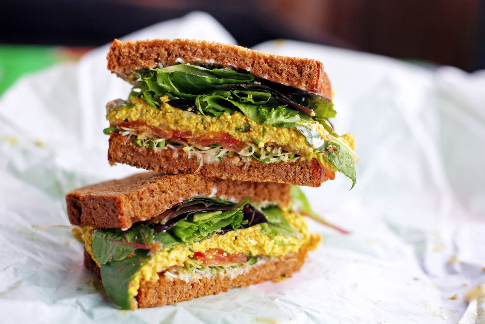 One of Lunchbox Cafe's new menu features, Organic Curry Tofu Salad Sandwich
