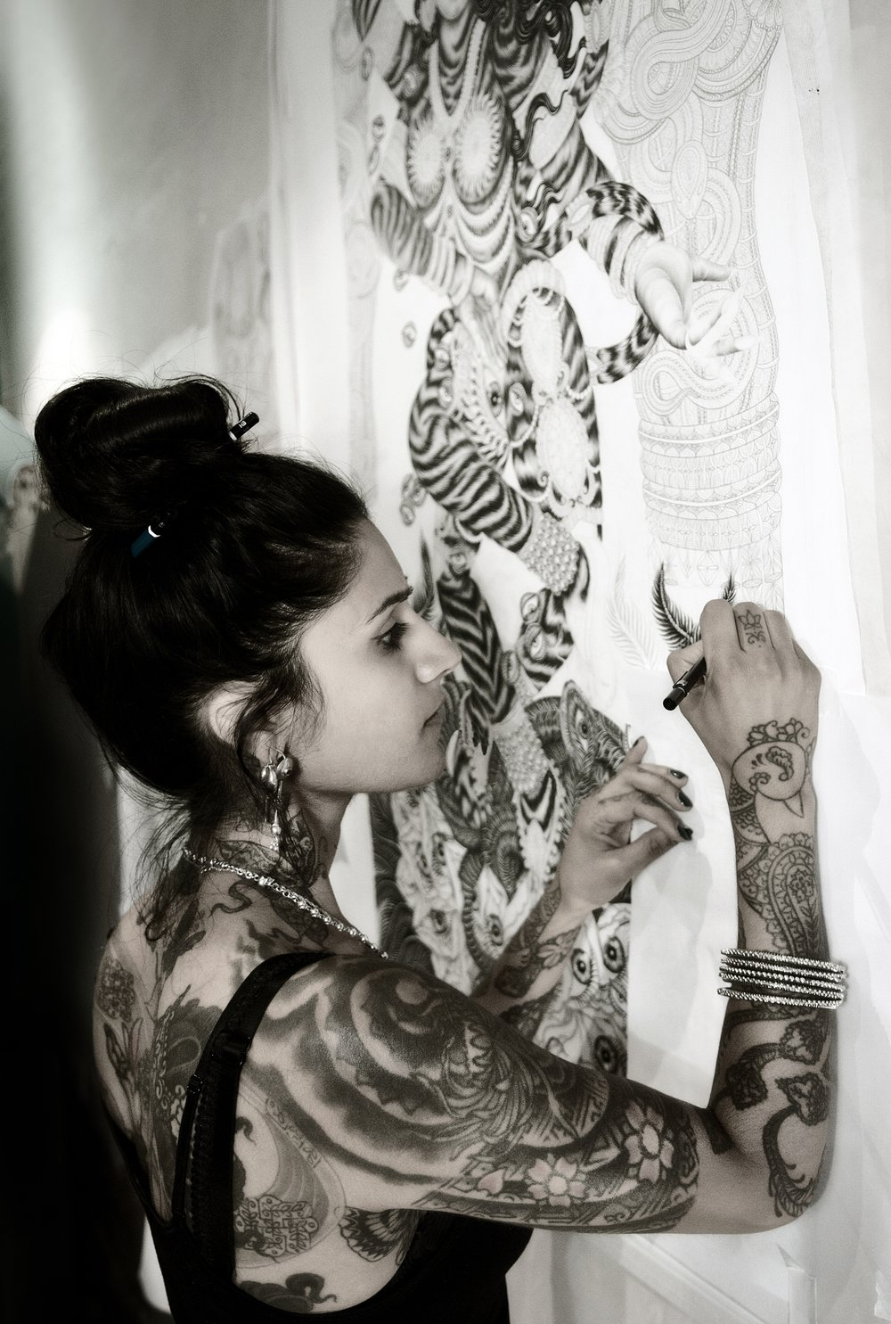 Saira Hunjan - Highly influenced by her Indian heritage and frequent trips to the country, Saira Hunjan's work often depicts images of nature, animals, and goddess figures. Her medium of choice is ink, which she has applied to both paper and skin. Known internationally as the Girl with the Golden Needle, Saira came to prominence in a career as a tattooist whilst studying fine art. This experience helped her refine and transform her visual language for her creative practice.Saira's connection to animals continues to be a great inspiration in her work. A proportion of the profits made by selling Saira's art will go to a charity in support of animals in Rajasthan, India. The work done by Tolfa India is very close to Saira's heart, as they provide shelter and medical support for animals in need.www.sairahunjan.comwww.tolfa.org.uk