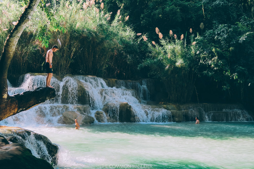 A man jumping into Kuang Si Waterfall, Luang Prabang
