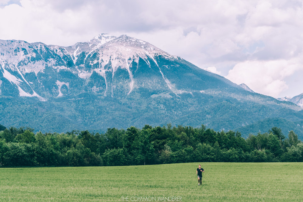 A man runs through fields in Lake Bled, Slovenia