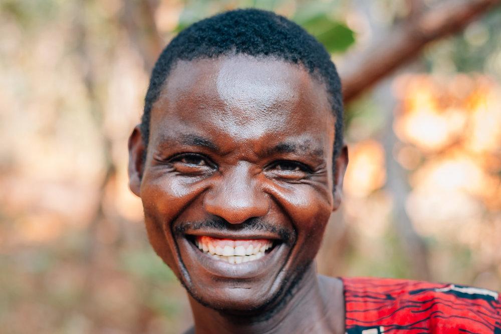 A Malawian man smiles near Livingstonia, Malawi