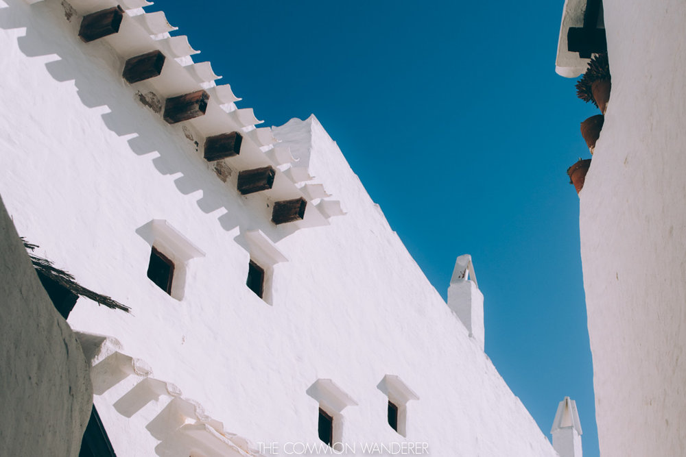 Afternoon shadows on buildings in Binibeca Vell, Menorca
