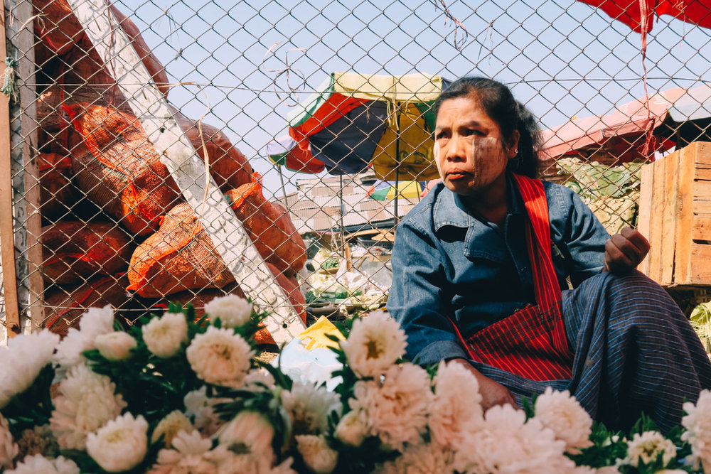 A lady selling flowers in a Yangon Market - Yangon circle line train