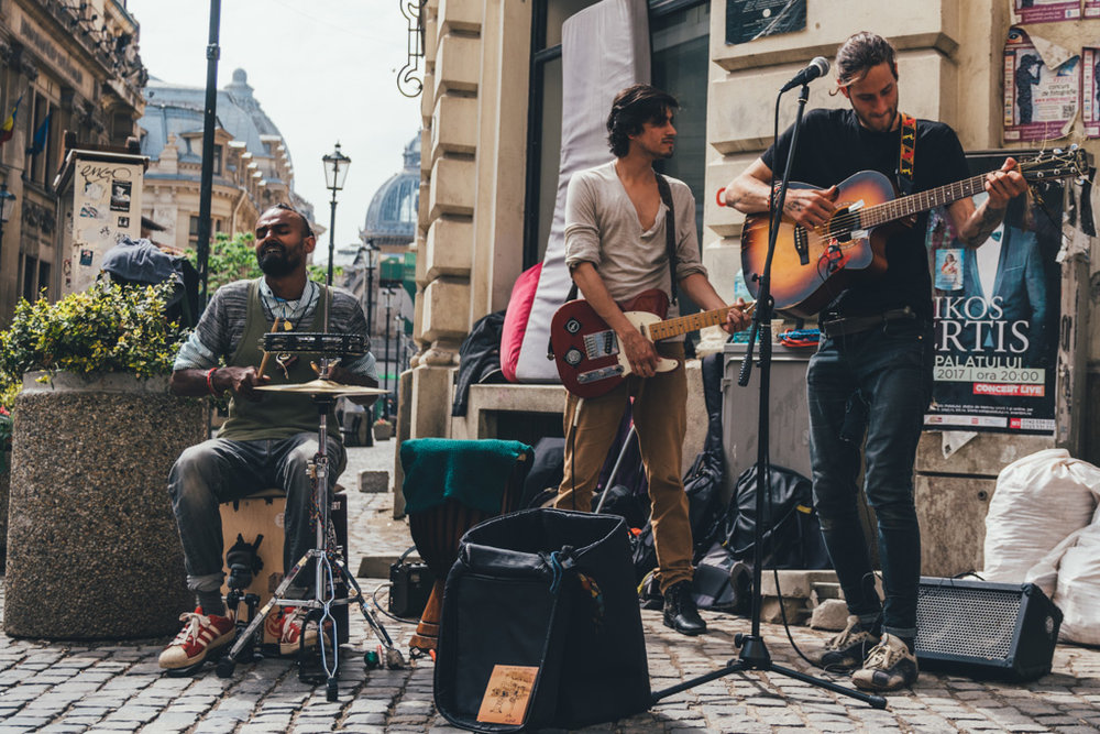Young Romanians busk in the streets of Bucharest