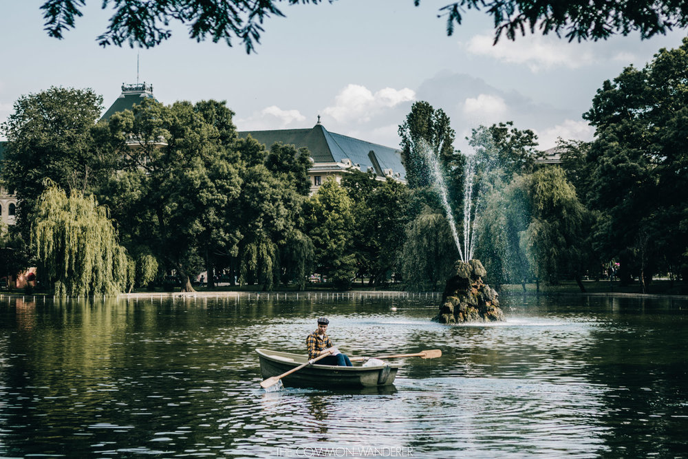 A man rows a paddle boat in Cisimigiu Park, Bucharest