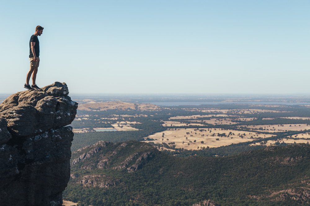 Standing on the edge of the Grampians on our road trip through Victoria