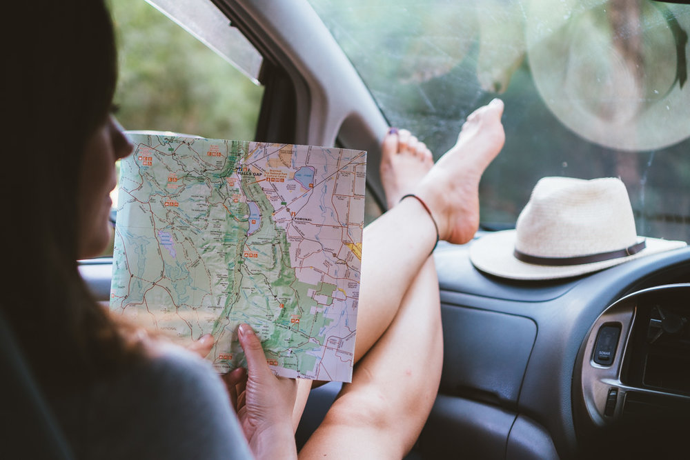 Reading a map on our road trip through Victoria, Australia